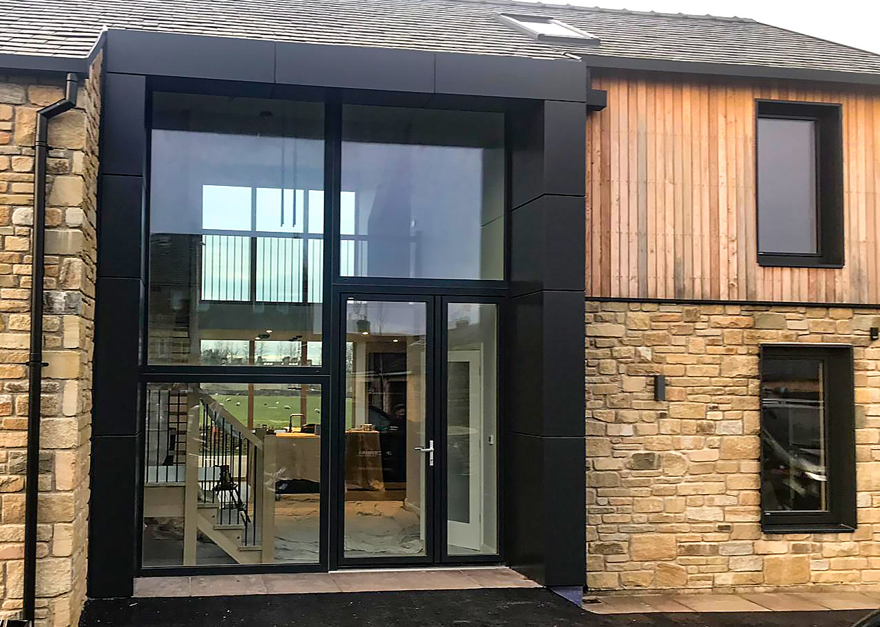 alumnium trims and cladding on a self-build house.